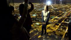 Tourists are photographed on the Glass Balcony at the Skydeck Willis Tower Stock Footage