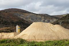 Pierced mountain quarry for stone quarrying and sand. Sand Mountain gravel pit Stock Photos