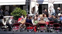 People relax rest in a street cafe in Vienna Austria - stock footage