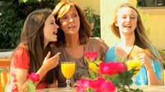 Lifestyle leisure Caucasian mother teenage girls sisters outdoor home together Stock Footage