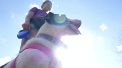 Young Woman Giving Her Dog a Treat Outdoors Stock Footage