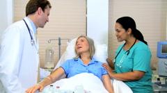 senior Caucasian female patient Hispanic nurse male medical clinical consultant - stock footage