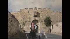 Vintage 16mm film, Jerusalem people walking in the old city, 1962 Stock Footage