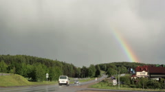 Rainbow over the road - stock footage