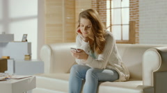 Young woman enjoying communication with friend in chat on phone Stock Footage