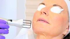 Non surgical cosmetic treatment senior Caucasian female Hispanic male specialist Stock Footage