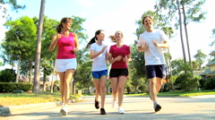 Caucasian family male female parents teenage girls jogging outdoor sport fitness Stock Footage