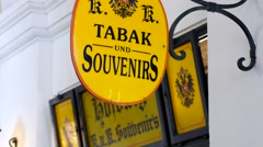 Souvenirs and tabak shop sign in Vienna Austria Stock Footage