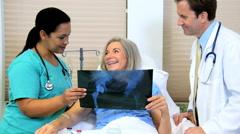 Female Caucasian hospital patient male doctor Hispanic nurse x-ray medical Stock Footage