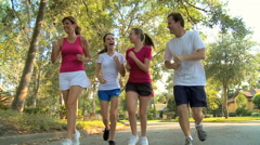 Young Western family male female parents teenage daughters jogging exercise Stock Footage