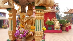 Little pavilion with four faces heads buddha sculpture, camera move around Stock Footage