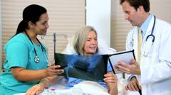 female Caucasian hospital patient male doctor Hispanic nurse x-ray medical - stock footage