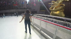 4k woman at Rockefeller Center Ice skating rink Stock Footage