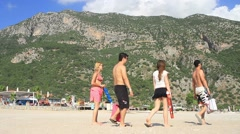 Group of young tourist exploring the beach Stock Footage