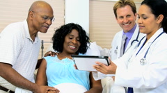 African American female patient Caucasian Hispanic male medical doctor tablet - stock footage