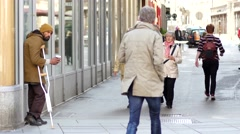 The beggar asks for money on a street in Vienna Stock Footage