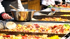 The market of street food in Budapest - outdoor food court cooking - stock footage