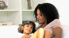 Infant African American female child girl loving mother playing indoors fun Stock Footage