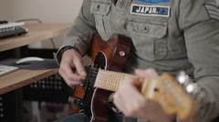 Focus in and out of man playing electric guitar Stock Footage