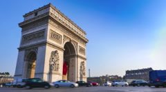 Arc de Triomphe in Paris and French flag Stock Footage