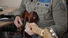 Track left and right of man playing electric guitar Stock Footage