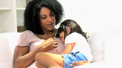 female ethnic parent mother young daughter child sleep togetherness home indoors - stock footage