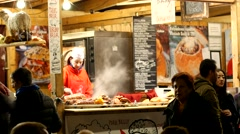 The market of street food in Budapest - outdoor food court cooking Stock Footage