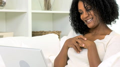 African American ethnic female wireless internet cloud technology home laptop - stock footage