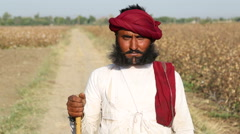 Portrait of local Indian man with unique beard at field road in Jodhpur. Stock Footage