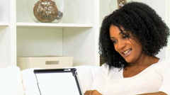 young African American female home online wireless tablet leisure lifestyle - stock footage