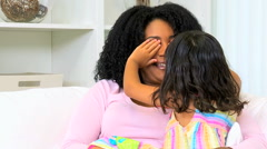 female ethnic parent mother young daughter child happy togetherness home indoors - stock footage
