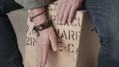 Closeup of man practising drum rhythms on wooden beat box Stock Footage