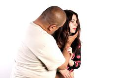 Studio shot of a man hurting a young lady Stock Photos