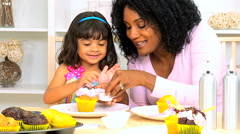 Female African American mother happy child home cooking baking cake relaxation Stock Footage