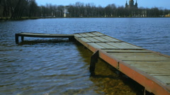 Old wooden jetty for mooring boats Stock Footage