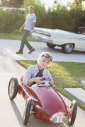 Smiling boy playing in go cart Stock Photos