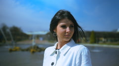 Young beautiful woman at fountain in Petrodvorets, St. Petersburg, Russia. Stock Footage