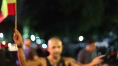 Interesting man waves rasta flag outside bar Stock Footage