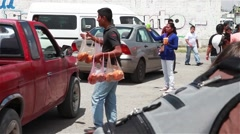 Mexican Drive-by Fruit and Drink Vendors - stock footage