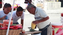 Pineapple Vendor Cutting - Mexican Market - stock footage