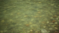 Shallow river over pebbles, close up, shallow DOF Stock Footage