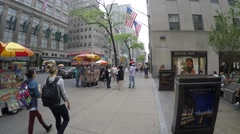 Pedestrians walk in 5th avenue in New York - stock footage