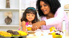 ethnic African American female child mother organic cupcakes icing togetherness - stock footage