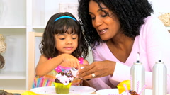 Young African American mother pre school girl together baking homemade future Stock Footage