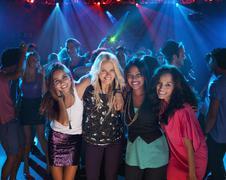 Portrait of smiling women on dance floor at nightclub Stock Photos