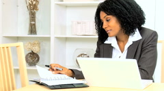 African American ethnic female business home working laptop computer smart phone Stock Footage