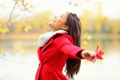 Happy autumn woman blissful - stock photo