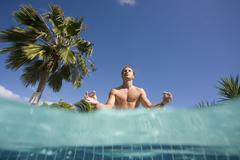 Man doing yoga poolside, Antigua, Caribbean Stock Photos