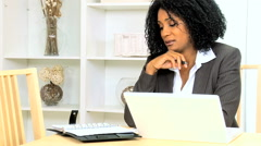 Business female African American home laptop smart phone wireless technology Stock Footage