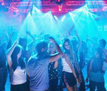 People dancing on dance floor of nightclub Stock Photos